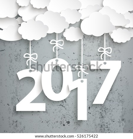 Paper clouds with text 2017 on the concrete background. Eps 10 vector file.