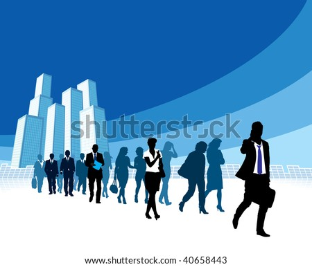 People are walking, large high buildings in the background.