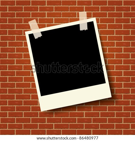 Photo frame on the brick wall - stock vector