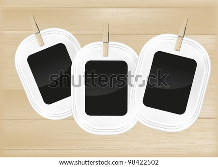 Photo frame set on light wood background - stock vector