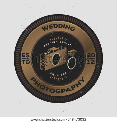 Photography Golden Badge and Label in Vintage Style. Creative wedding photographer logo with camera and wedding rings. Dark version. - stock vector