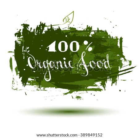 phrase organic food is hand-written on a green background