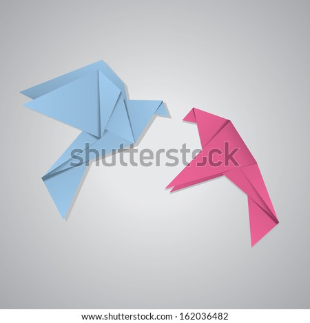 Pink and blue origami pigeons on grey background.