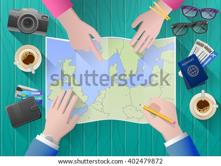 Planning a trip to Europe. Young couple adventurous. Travel agency chooses the tour desk. top view - stock vector