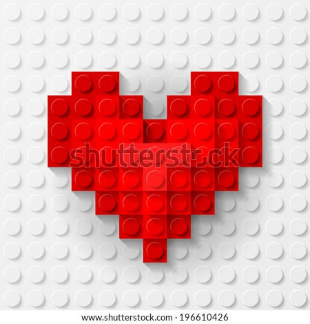 Plastic red heart on white background made of construction kit - stock vector