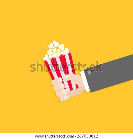 Popcorn. Businessman hand. Cinema icon in flat design style. Vector illustration - stock vector