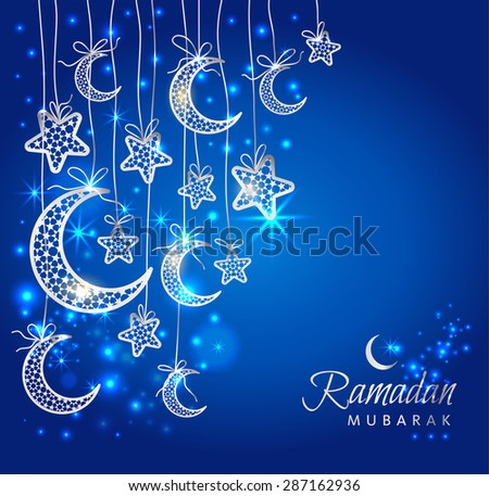 Ramadan greeting card on blue with silver moons and stars.