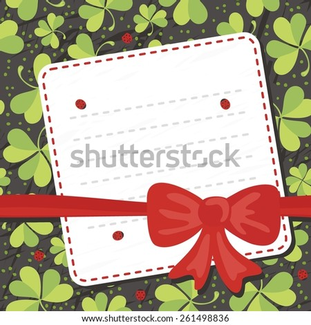 red bow on clover meadow with ladybugs blank card with place for your text on dark background