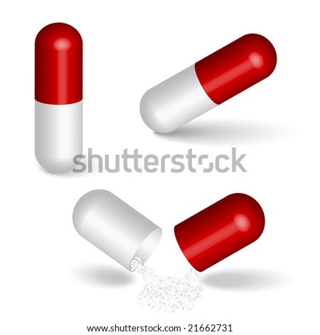 Red capsules isolated on white
