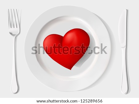 red heart on a plate, fork and knife on a white background