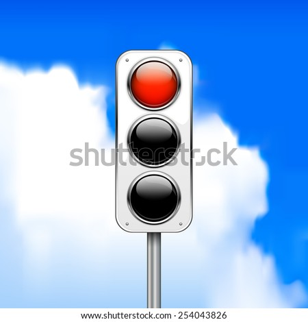 Red traffic light against the blue sky with clouds