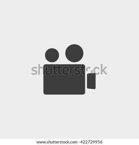 Retro movie camera in black color. Vector illustration eps10 - stock vector