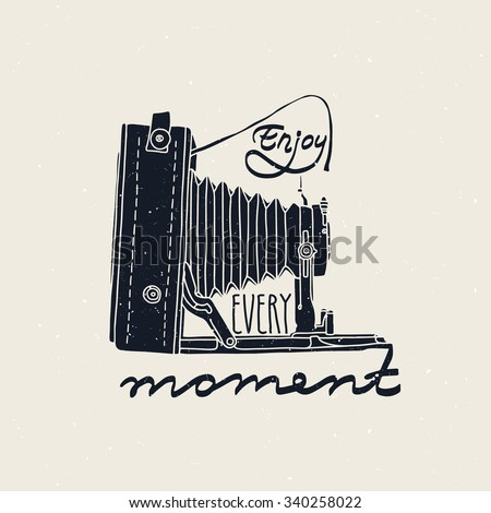 """Retro photo camera with """"Enjoy every moment"""" quote - stock vector"""
