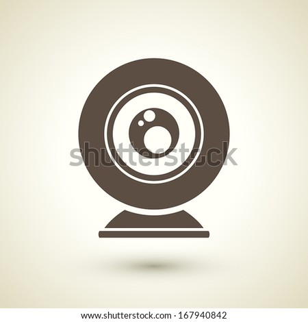 retro style web camera icon isolated on brown background