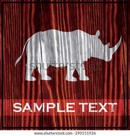 Rhino silhouette painted on wooden board with white paint - stock vector