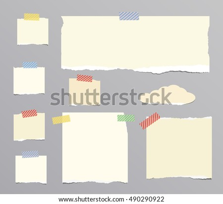 Ripped beige, brown notebook, note paper stuck on gray background