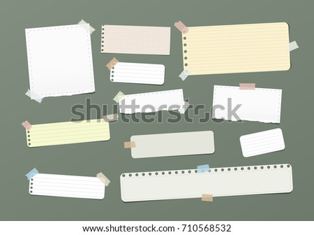 Ripped blank, ruled note, notebook, copybook paper strips stuck with colorful sticky tape on green background.