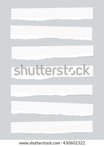 Ripped white blank paper pieces are stuck on striped background.