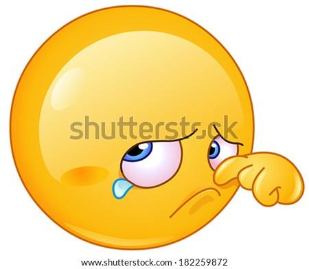 Sad emoticon wiping tear - stock vector