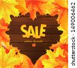 Sale. Autumn leaves on a wooden background - stock vector