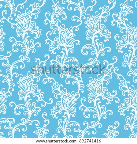 Seamless ornamental vector floral pattern on blue background