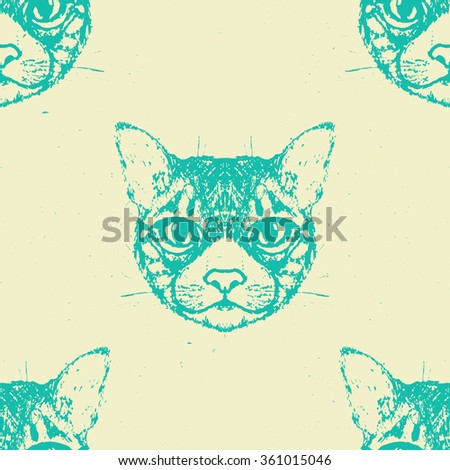 Seamless Pattern of a cat heads. Vector illustration.