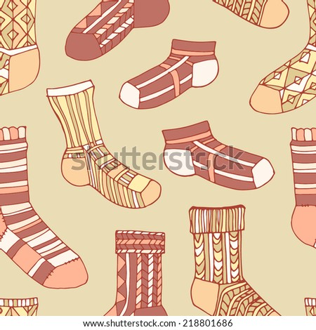 Seamless pattern with decorated socks. Socks with red, white, orange, yellow and ocher ornament on a beige background. - stock vector