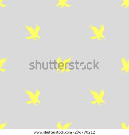 Seamless pattern with silhouettes of flying eagle yellow on a gray background - stock vector