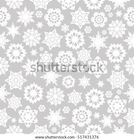 Seamless pattern with  snowflakes on a gray background.Happy New Year background