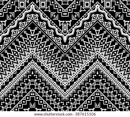 Seamless stylized chevron pattern with aztec ethnic and tribal ornament.  Vector black and white fashion illustration. - stock vector
