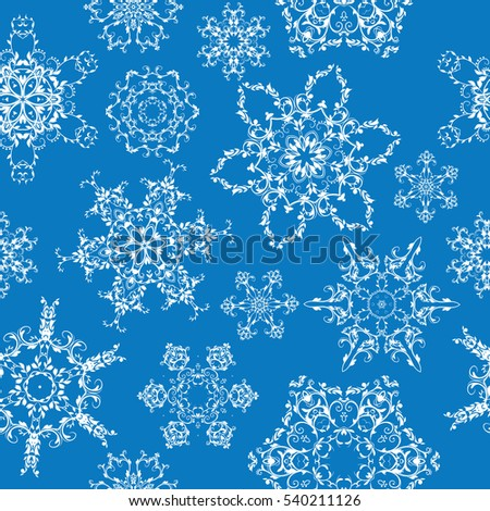 Seamless texture of snowflakes. Tile background with snowflakes