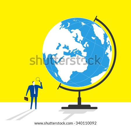 Searching- A businessman is holding a magnifier and looking on a globe