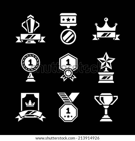 Set icons of awards and trophy isolated on black. Vector illustration - stock vector