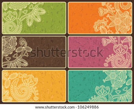 Set of business cards with abstract floral pattern and grunge background in bright colors - stock vector