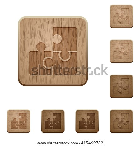 Set of carved wooden puzzle buttons in 8 variations.