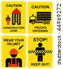 Set of caution signs for construction zone. hard hat area.Yellow and black vector icons. Construction area. Trucks entering. Wear your helmet. Stop, keep out, keep away, do not cross. - stock vector