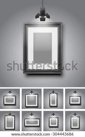 Set of different black frames gallery room gray wall interior illuminated with spotlights. Realistic 3d vector illustration - stock vector