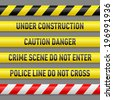 Set of different danger tapes. Tapes with text Under construction, Caution Danger, Crime scene do not enter, Police line do not cross - stock photo