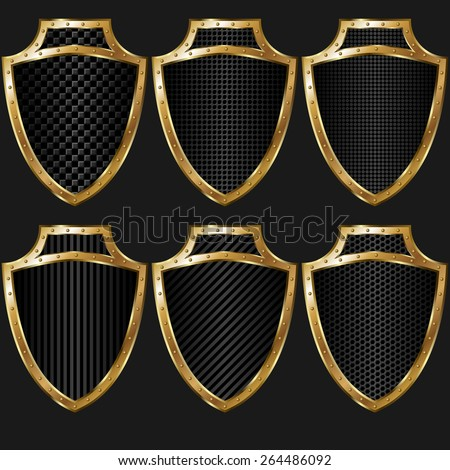 set of gold shields with texture - stock vector