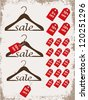 """Set of hangers with tags and word """"sale"""" on grunge background - stock photo"""