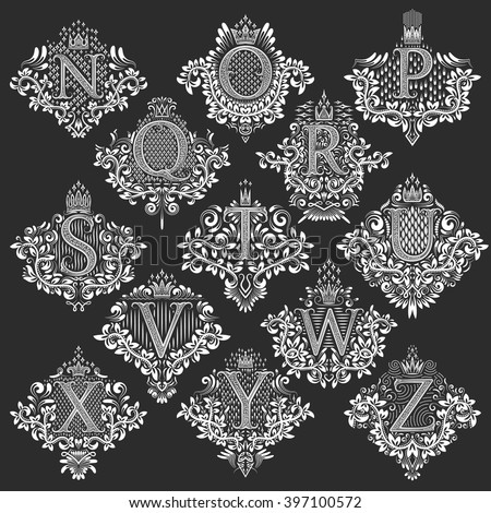 Set of heraldic monograms in coats of arms form. White floral decorative stamps of letters from N to Z. Isolated tattoo labels in vintage baroque style. - stock vector