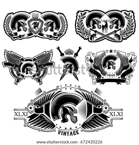 Set of labels with Spartan helmets, wreathes, sword, animals and wing. Heraldic vintage elements on white