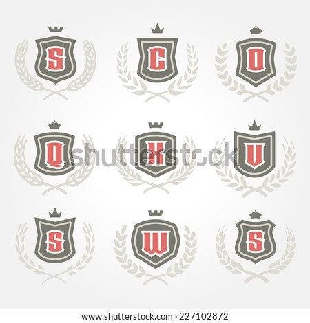 Set of laurel foliate wheat wreaths and heraldry monogram design elements for creating classic heraldic logos - stock vector