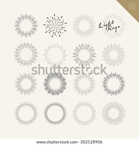 Set of light rays vintage design elements. Vector hand drawn sunburst elements for graphic and web design.      - stock vector