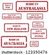 Set of red rubber stamps of Made In symbols for Australasia region, including Australia, New Zealand, Fiji, Cook Islands, Solomon Islands, Vanuatu, Tonga, Papua New Guinea - stock photo