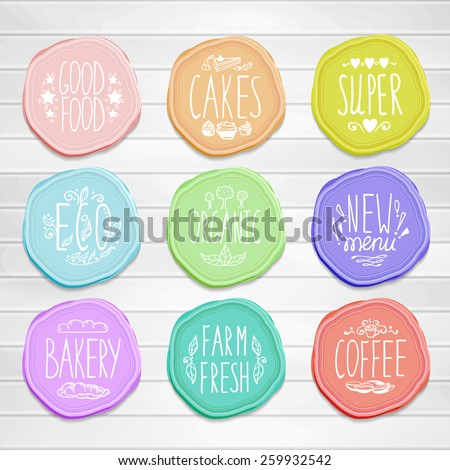 Set of retro badges on a wood background. Hand-drawn lettering and elements. Creative colored handmade food labels with inscriptions in vintage style. - stock vector