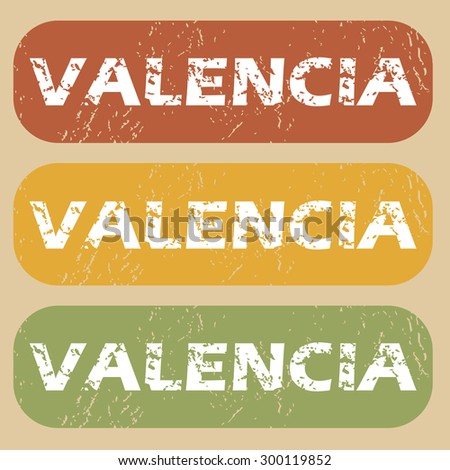 Set of rubber stamps with city name Valencia on colored background - stock vector