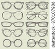 set of vector sketched glasses - stock vector