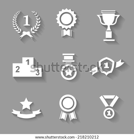 Set of white vector award  success and victory icons with trophies  stars  cups  ribbons  rosettes  medals medallions  wreath and a podium on grey - stock vector