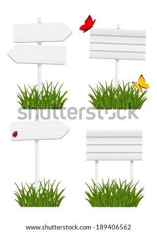 Set of wooden signboards in green grass - stock vector